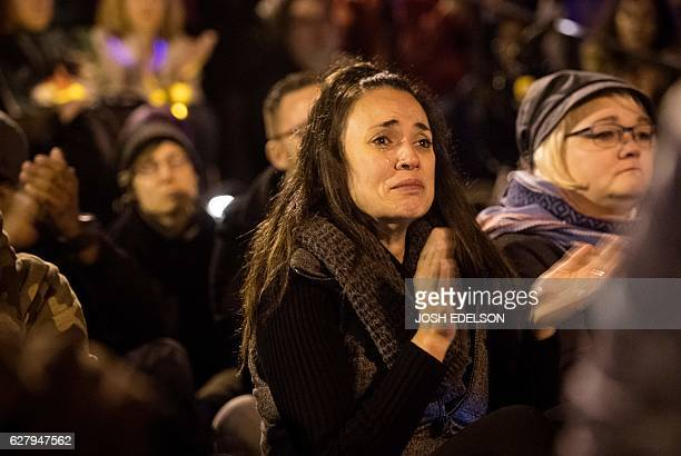 A woman cries during a vigil honoring those who died in a warehouse fire in Oakland California on December 05 2016 More than 4000 people came to...