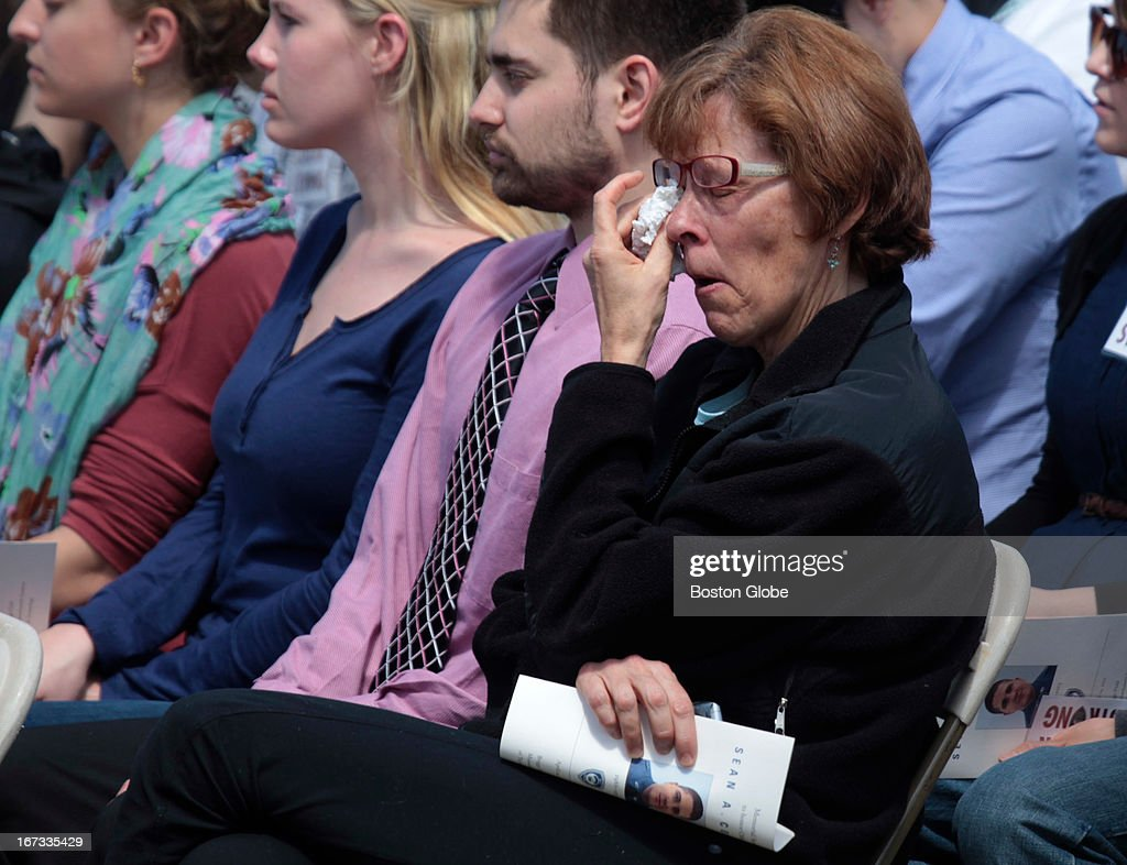 A woman cries during the memorial service MIT police officer Sean Collier, at Briggs Field, on the MIT campus. Collier was killed during a shootout with the Boston Marathon bombing suspects.