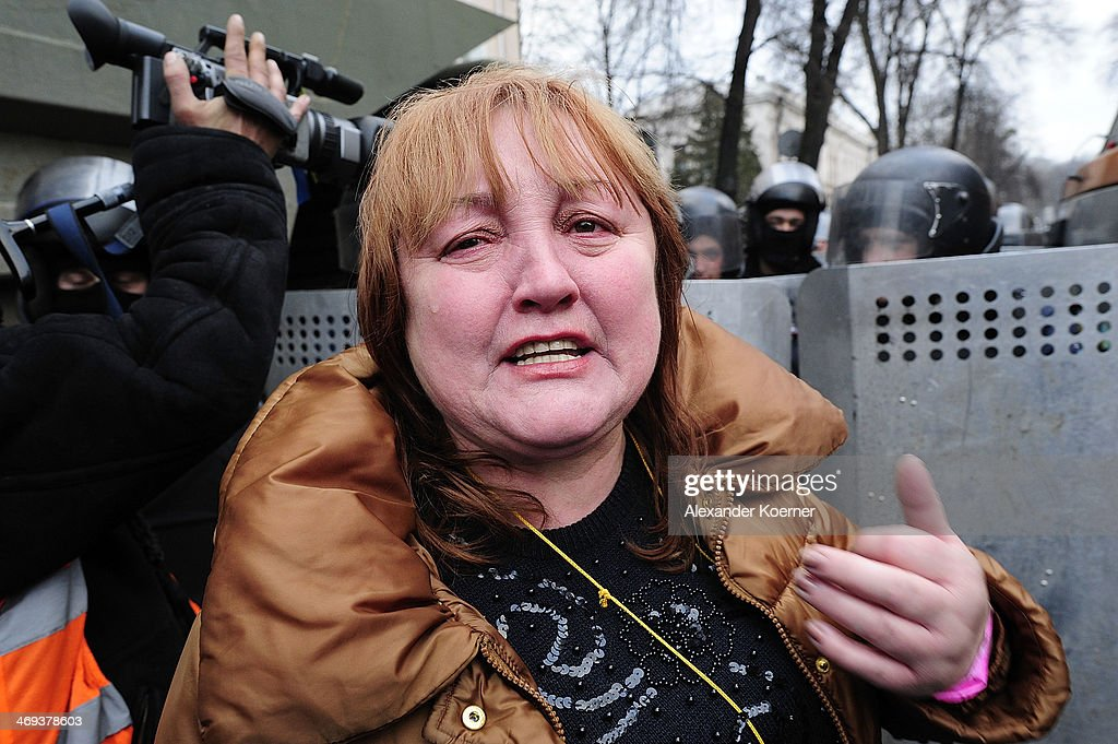 A woman cries in front of riot police forces during a rally of anti-government protesters on Instytutska Street on February 14, 2014, in Kiev, Ukraine. According to Opposition Officals, Berkut police forces could attack the barricades any moment; protesters have gathered inside and prepared fireworks and molotov-cocktails. Media and other people were removed from the barricades. Russian Foreign Minister Sergei Lavrov again issued a warning to the West against interfering in Ukraine's political crisis during today's joint press conference with German federal foreign Minister Walter Steinmeier, who is on a two-day visit to Russia. According to reports Ukrainian opposition leaders Vitaly Klitschko and Arseny Yatsenyuk are set to meet with German Chancellor Angela Merkel on February 18, 2014 in Germany.