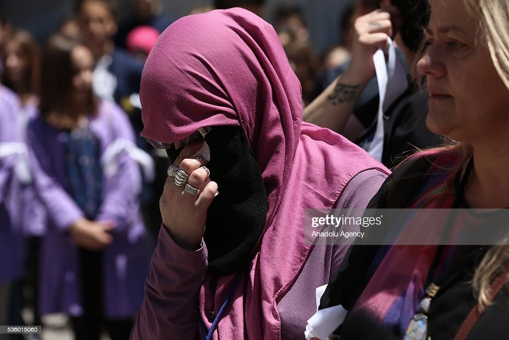 A woman cries in front of the Cathedral of Jesus' Heart during a commemoration ceremony at the Cathedral of Jesus' Heart for non-Serb civilians killed in the war on the territory of western town of Prijedor, in Sarajevo, Bosnia and Herzegovina on May 31, 2016.