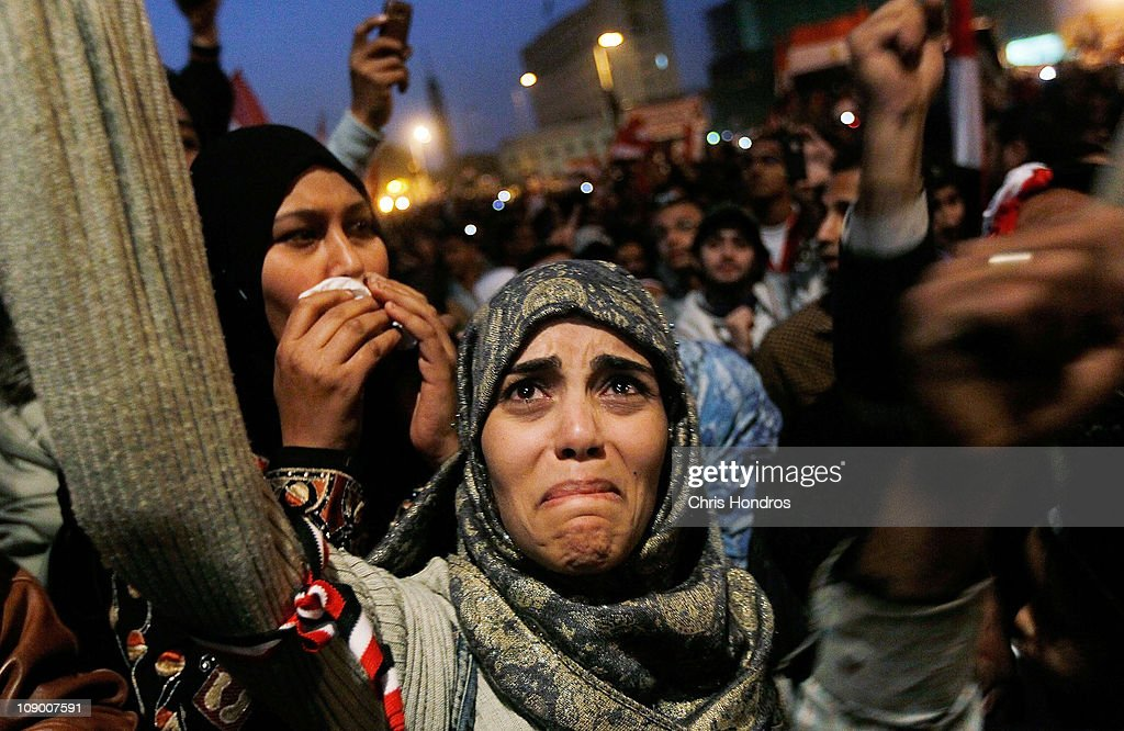 A woman cries in Tahrir Square after it is announced that Egyptian President Hosni Mubarak was giving up power February 11 2011 in Cairo Egypt After...