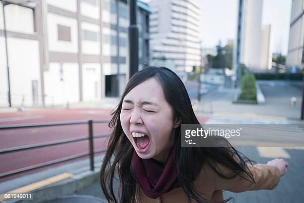 A woman cries loud outside.
