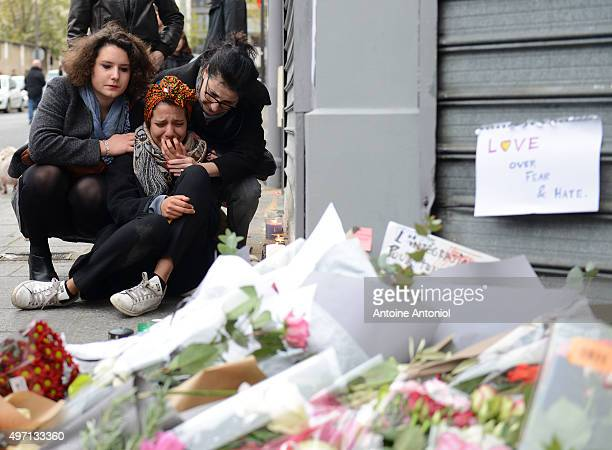 A woman cries near Le Petit Cambodge restaurant the day after a deadly attack on November 14 2015 in Paris France At least 120 people have been...