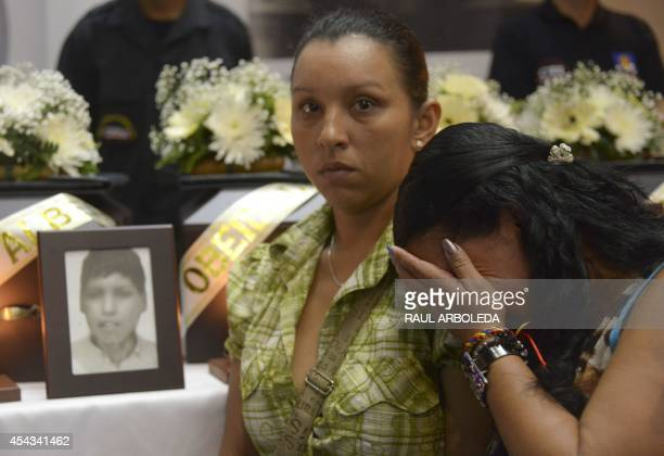 A woman cries next to funerary urns containing remains of people disappeared during the Colombian civil war during a ceremony in the framework of the...
