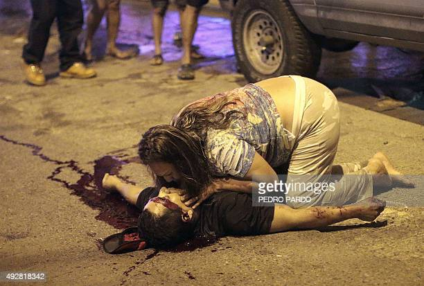 A woman cries on the body of her murdered husband in the tourist city of Acapulco Guerrero State Mexico on October 1 2015 Acapulco once known as a...