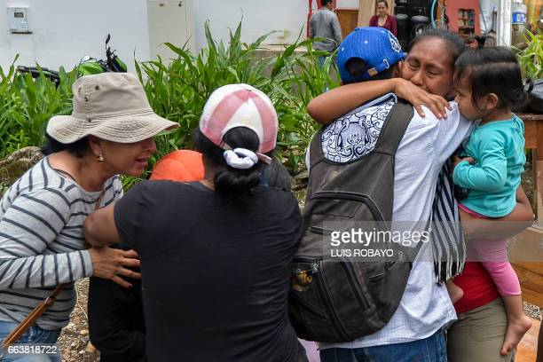 A woman cries when she is reunited with her family amidst the rubble left by mudslides following heavy rains in Mocoa Putumayo department southern...