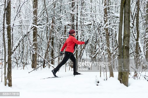 Woman cross-country skiing, snow, winter sport.