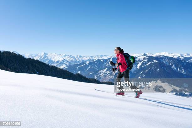 Woman cross-country skiing, Zell am see, Salzburg, Austria