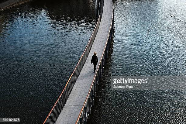 A woman crosses a bridge on April 6 2016 in Reykjavik Iceland Icelandic Prime Minister Sigmundur David Gunnlaugsson has stepped down after news broke...