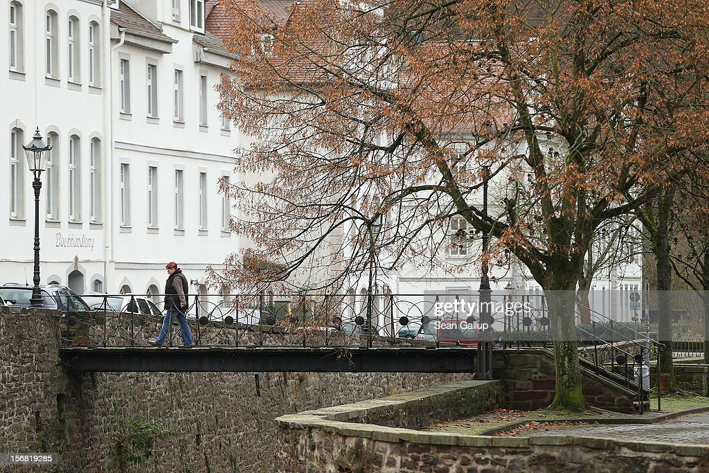 A woman crosses a pedestrian bridge on November 19, 2012 in Bad Karlshafen, Germany. Bad Karlshafen was heavily settled by Huguenot refugees in the early 18th-century and lies along the 'Fairy Tale Road' (in German: Die Maerchenstrasse) that leads through the region between Frankfurt and Bremen where the Grimm brothers collected and adapted most of their fairy tales, which include such global classics as Sleeping Beauty, Little Red Riding Hood, Rapunzel, Cinderella and Hansel and Gretel, in the early 19th century. Among the most important sources for many of the tales was Huguenot descendant Dorothea Viehmann.The 200th anniversary of the first publication of the stories will take place this coming December 20th.