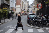 A woman crosses a road on November 12 2012 in a 30 km speed limit zone in Paris Paris Mayor Bertrand Delanoe has called for a plan of reduction in...