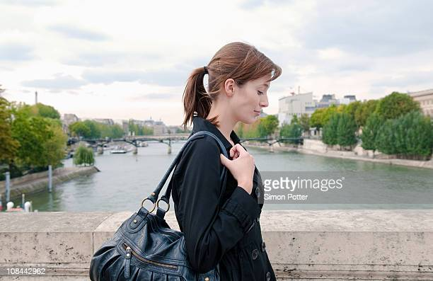 Woman crosses river Seine on foot
