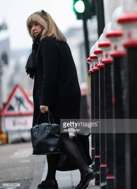 A woman crosses the street outside Cannon Street Station on March 27 2017 in London England British Prime Minister Theresa May will trigger article...