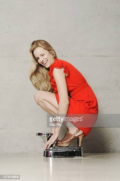 Sexy Squatting Woman Stock Photos and Pictures | Getty Images