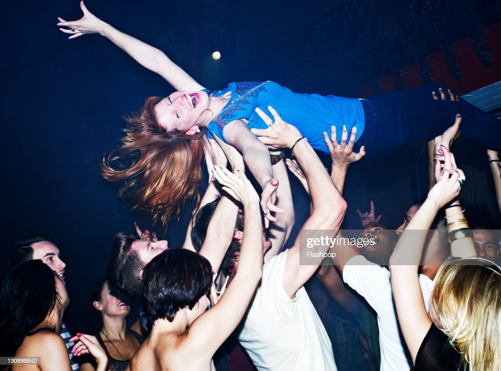 Woman crowd surfing : Stock Photo