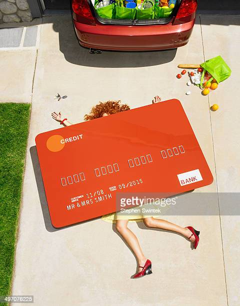 woman crushed under oversized credit card