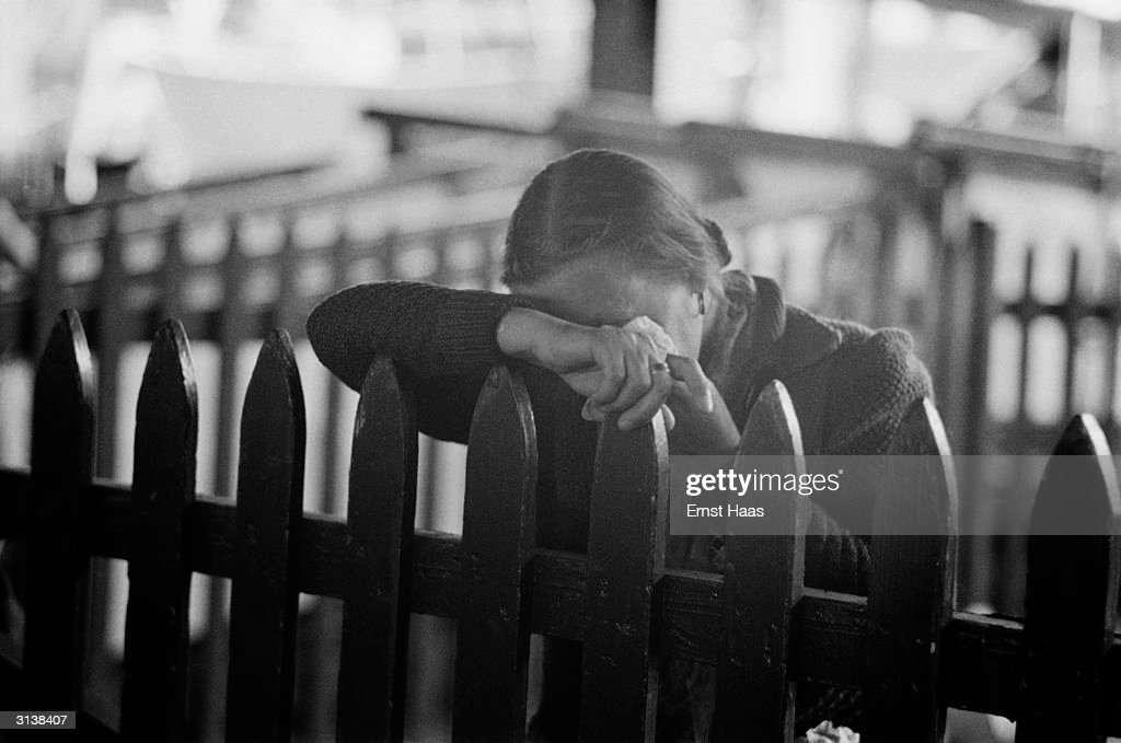 A woman crying at Ellis Island having travelled to America on the last displaced persons boat to sail from Europe.