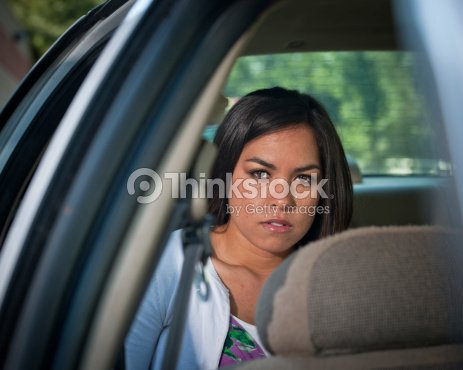 Woman Crying In Back Seat Of Police Car Stock Photo