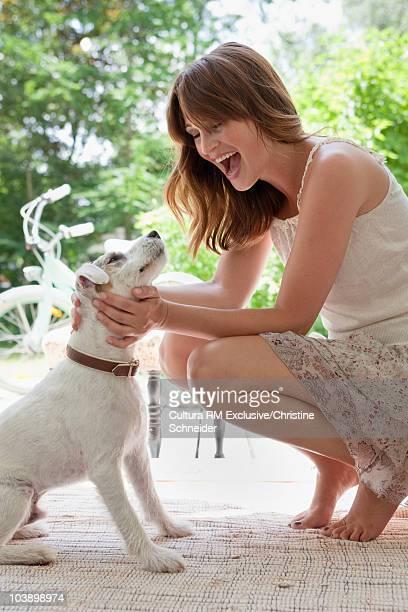 Woman cuddling her dog