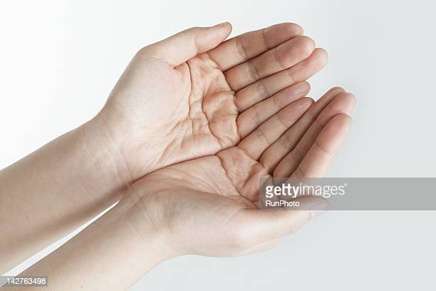 Woman cupping palms, close-up