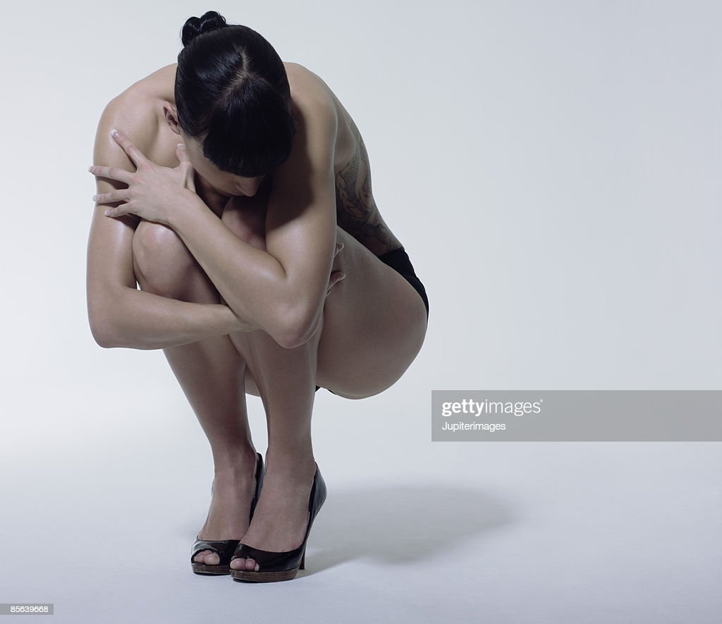 Woman curled up : Stock Photo