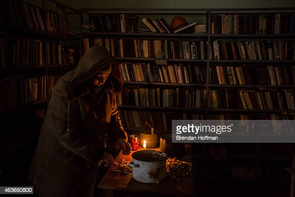 A woman cuts potatoes for a communal meal in the village library at the local House of Culture on February 17 2015 in Myronivskyi Ukraine A ceasefire...