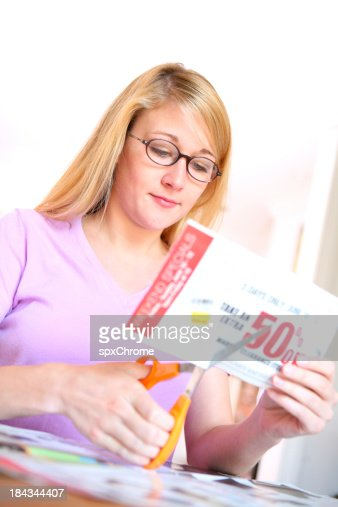 Woman Cutting Coupons
