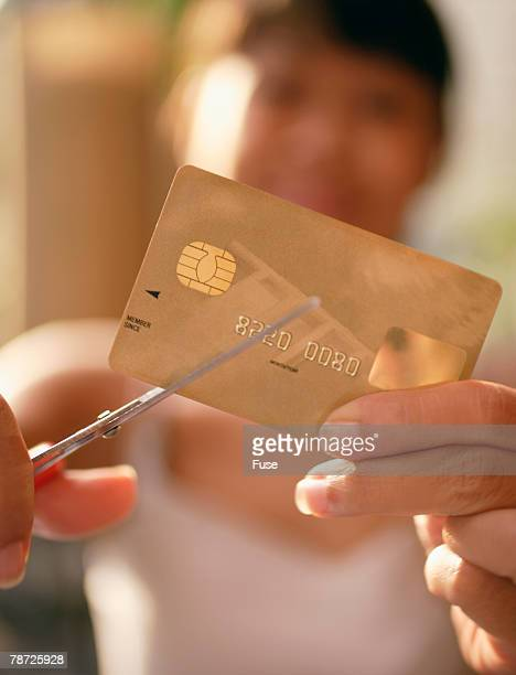 Woman Cutting Her Credit Card