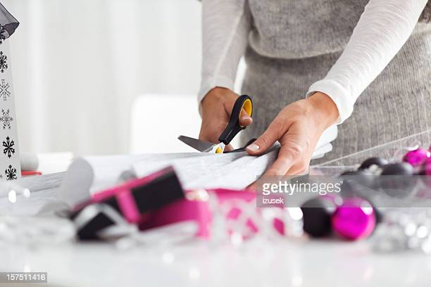 Woman Cutting Wrapping Paper