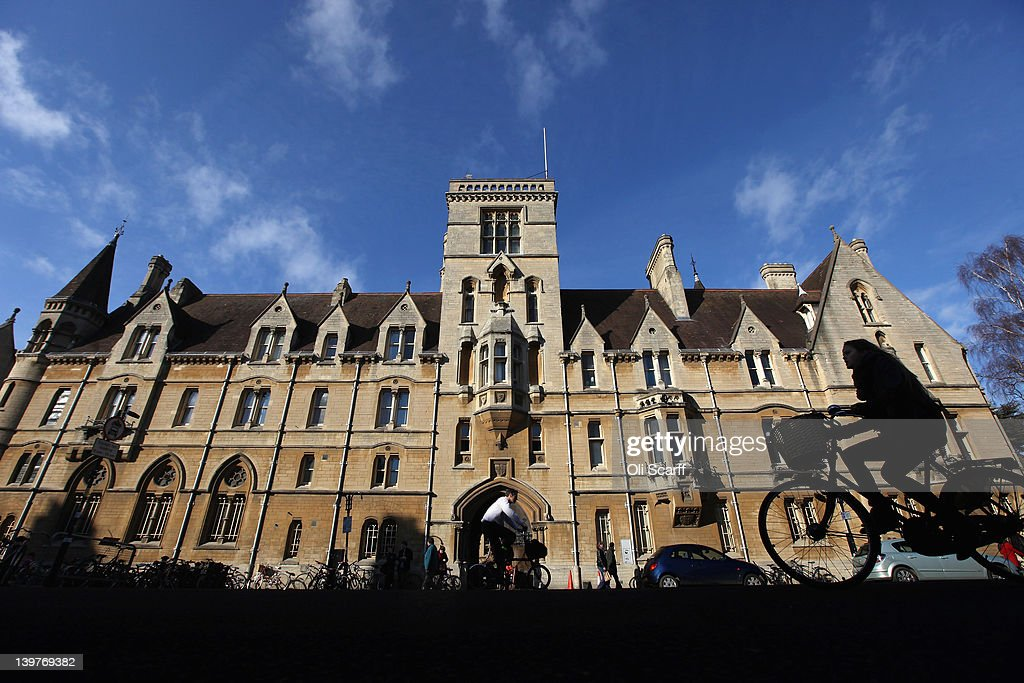 A woman cycles past Balliol College in Oxford city centre on February 24 2012 in Oxford England Oxford University has a student population in excess...