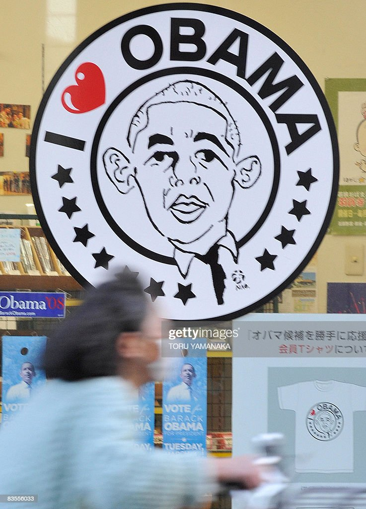 A woman cycles past 'I Love Obama'' poster in support US Democratic Presidential candidate Senator Barack Obama in Obama city western Japan on...