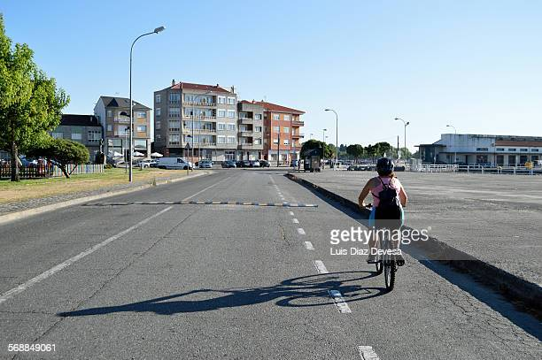 Woman cycling on her bike