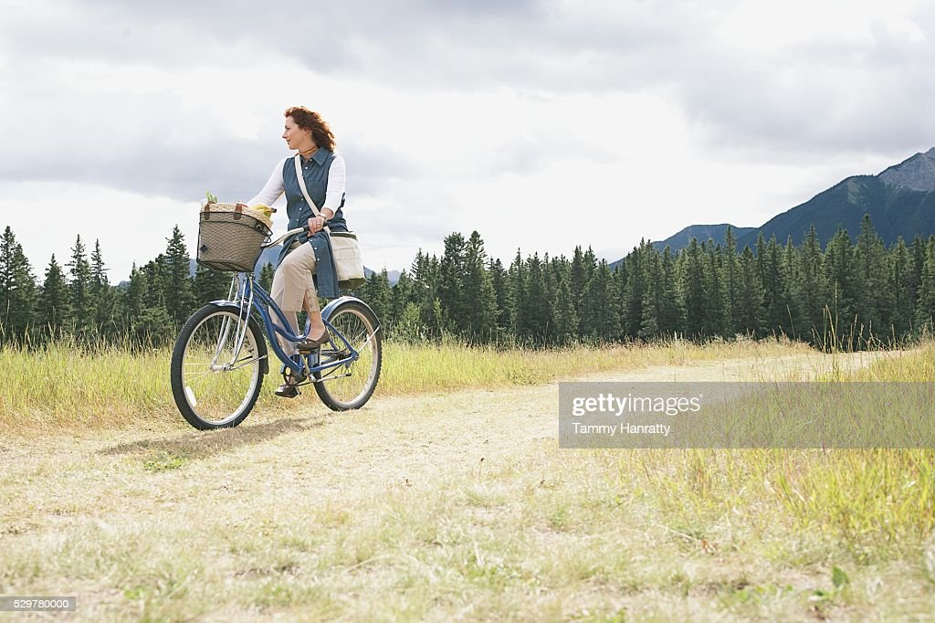 Woman cycling : Stock Photo