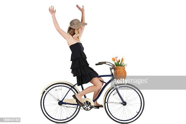 Woman cycling without holding the handlebars