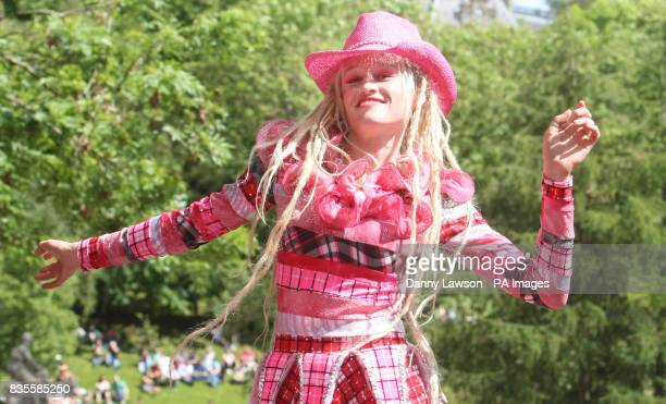 A woman dances as The West End Festival gets under way with 'Scotland's Mardi Gras' where over one thousand costumed performers and bands paraded in...