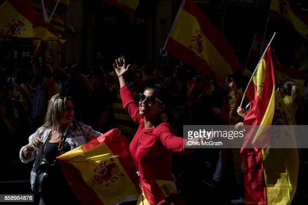 A woman dances down the street while taking part in a protest against Catalonia's indepedence on October 8 2017 in Barcelona Spain Large numbers of...