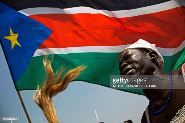 A woman dances during a welcoming ceremony for The King of Morocco on February 1 at Juba airport at the start of his two day visit to South Sudan /...