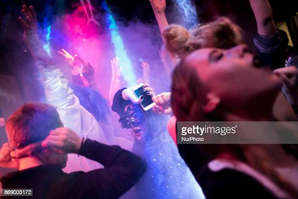 Woman dances during Halloween party in Warsaw on October 31 2017