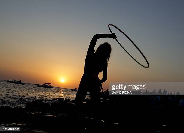 A woman dances during sunset at Cafe del Mar in San Antonio de Portmany on Ibiza Island on July 10 2015 AFP PHOTO/ JAIME REINA