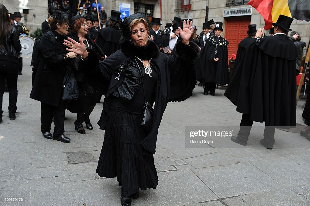 A woman dances during the ''Burial of the Sardine'' procession on February 10, 2016 in Madrid, Spain. The Sardine procession is a centuries-old Spanish tradition made famous by a painting by Spanish artist Francisco de Goya called 'El Entierro de La Sardina'. The mourners hold a mock funeral procession mourning the end of Carnival through the heart of old 'Castizo' Madrid visiting and enjoying the wines and tapas of local taverns.