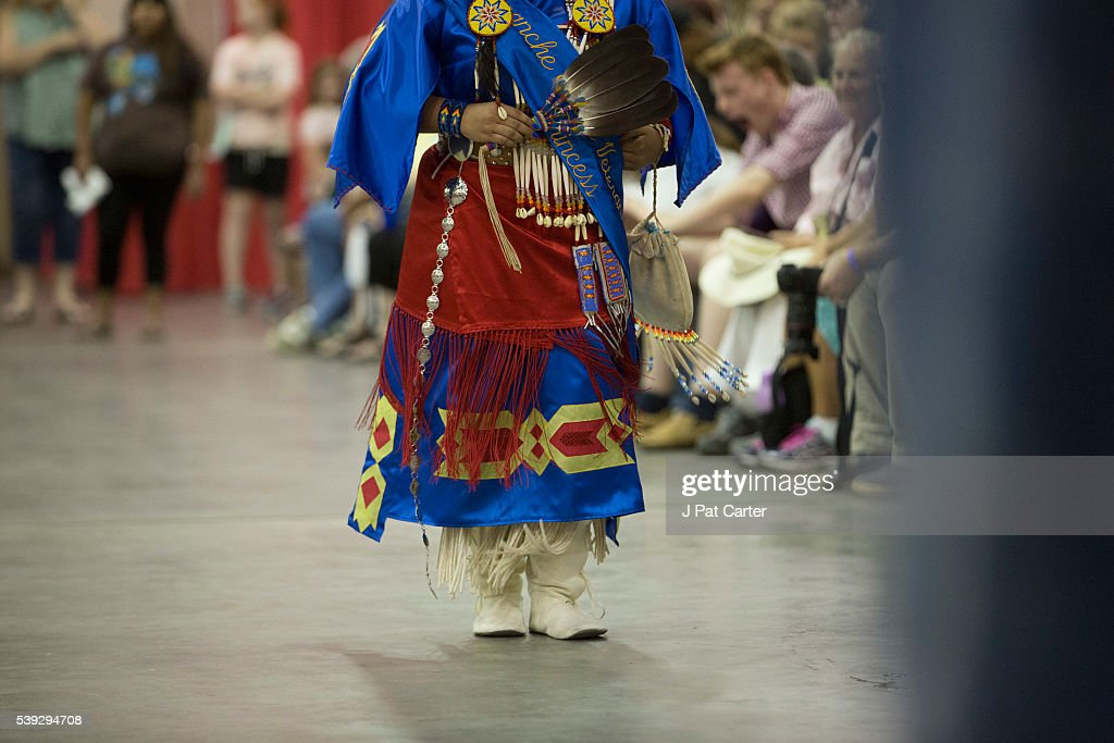 A woman dances in the Southern Cloth group at the Red Earth Native American Festival, Friday, June 10, 2016 in Oklahoma City.