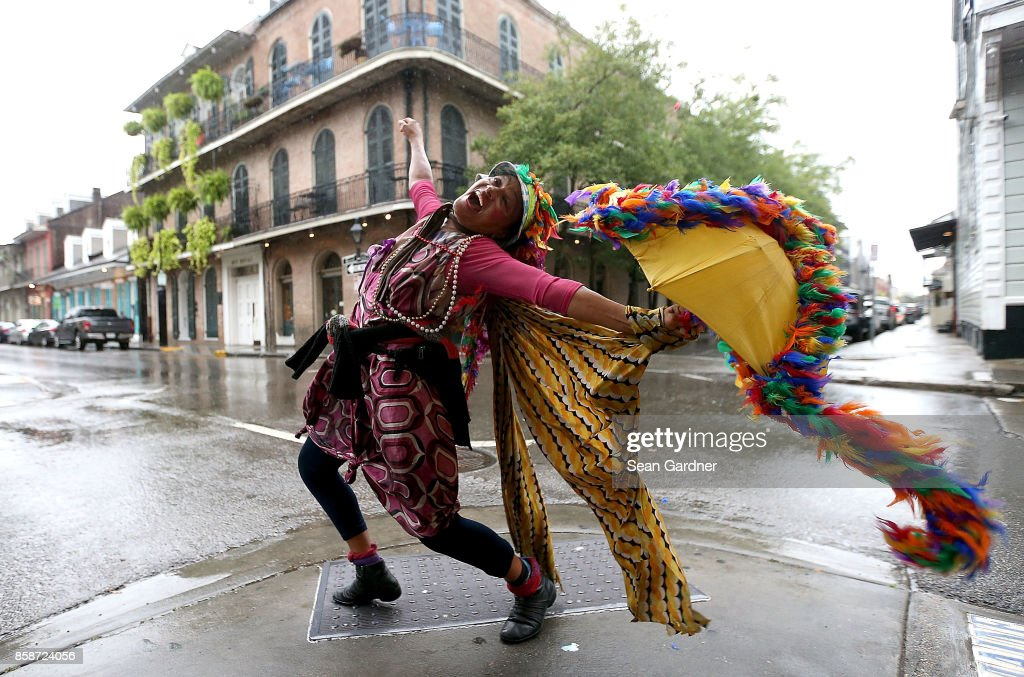 A woman dances in the street in the French Quarter before Hurricane Nate makes landfall on October 7, 2017 in New Orleans, Louisiana. Nate is expected to make landfall as a category 2 hurrincane near Biloxi, Mississippi later this evening.