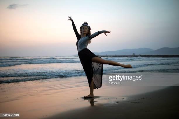 Woman Dancing At Beach