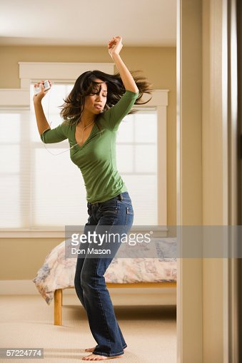 Woman dancing in bedroom while listening to music   Stock Photo. Woman Dancing In Bedroom While Listening To Music Stock Photo