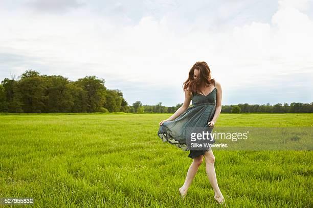 Woman dancing in green meadow
