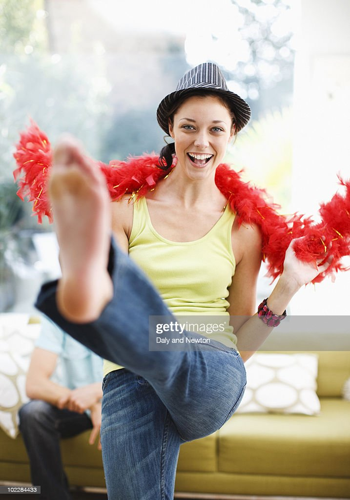 Woman dancing in hat and feather boa : Stock Photo