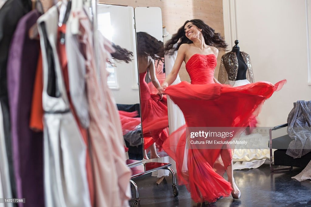 Woman dancing in ornate gown : Stock Photo