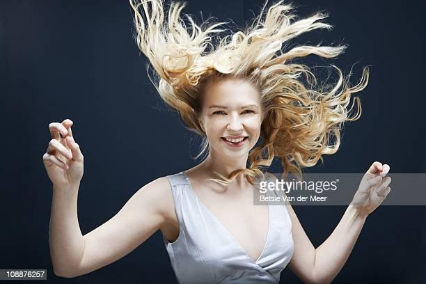 Woman dancing in wind.