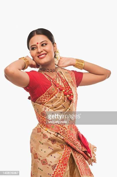 Woman dancing on Bihu festival
