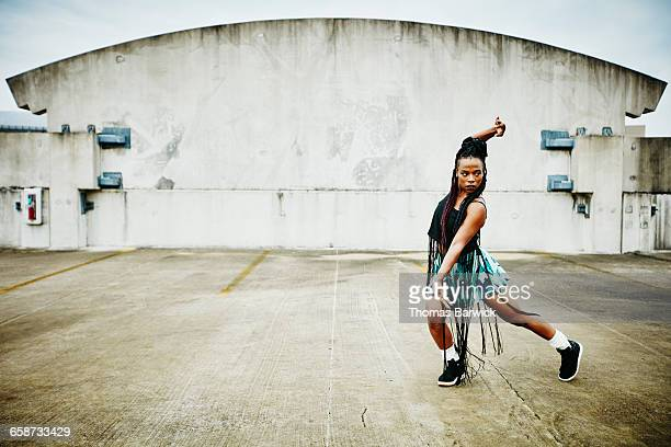 Woman dancing on rooftop of building